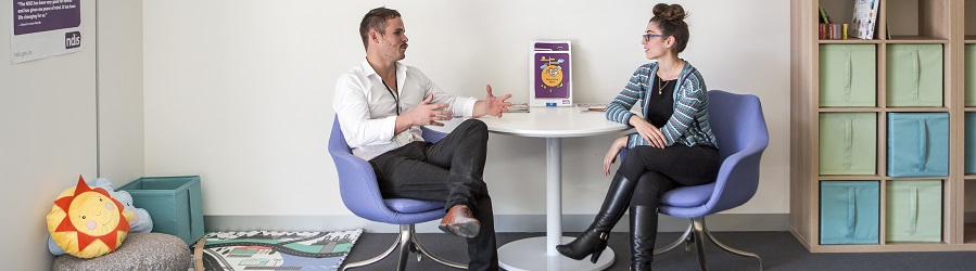 Two Brotherhood team members in discussion within a Brotherhood NDIS office