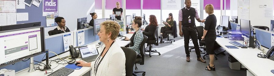 Image depicting the inside of a spacious and bright Brotherhood NDIS office with Brotherhood LAC staff working at their desks.