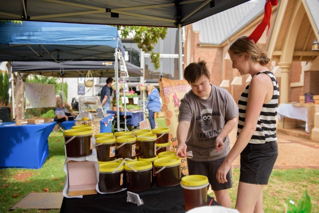 NDIS participants taking part in outdoor market