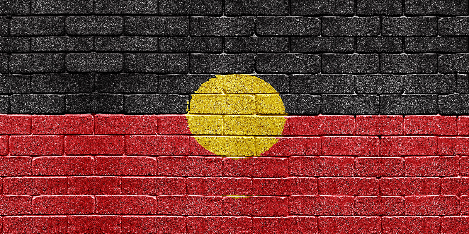 Aboriginal flag painted onto a wall