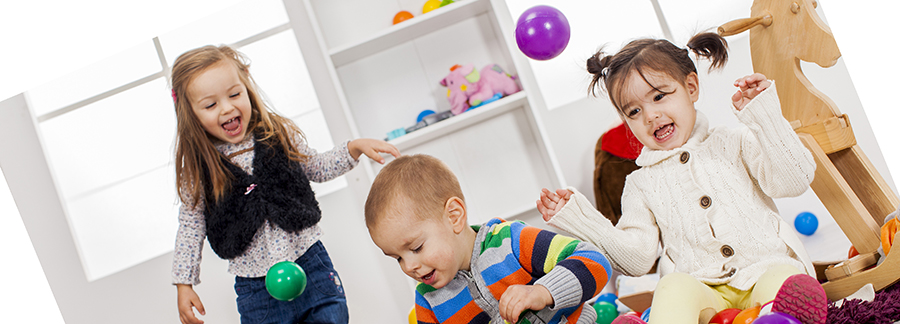 Stock image of group of children playing with some toys in play group