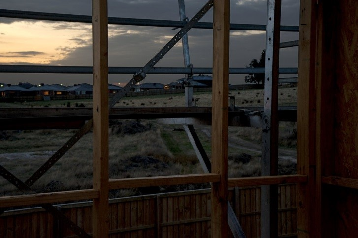 Looking out of a building to a sunset