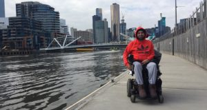 Mahmood in a wheelchair beside the Yarra River