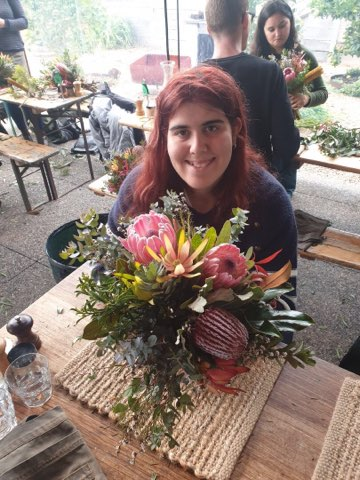 Young girl smiling with a bouquet of flowers