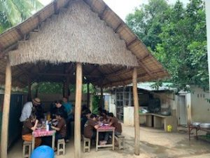 A group of people eating lunch outside